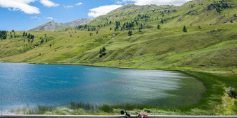 Peaceful lake after a long climb in the Alps